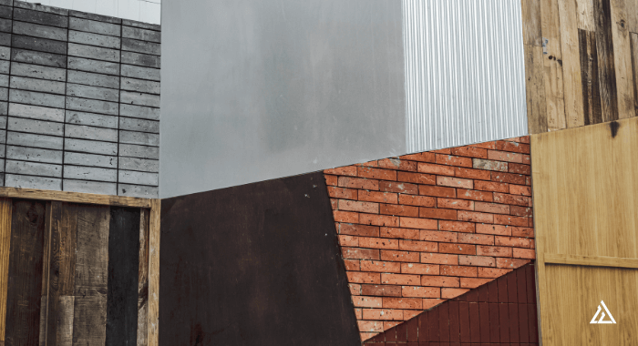 Photo of a wall that is composed of several materials. They represent the diversity and flexibility of use of natural materials in several industries.